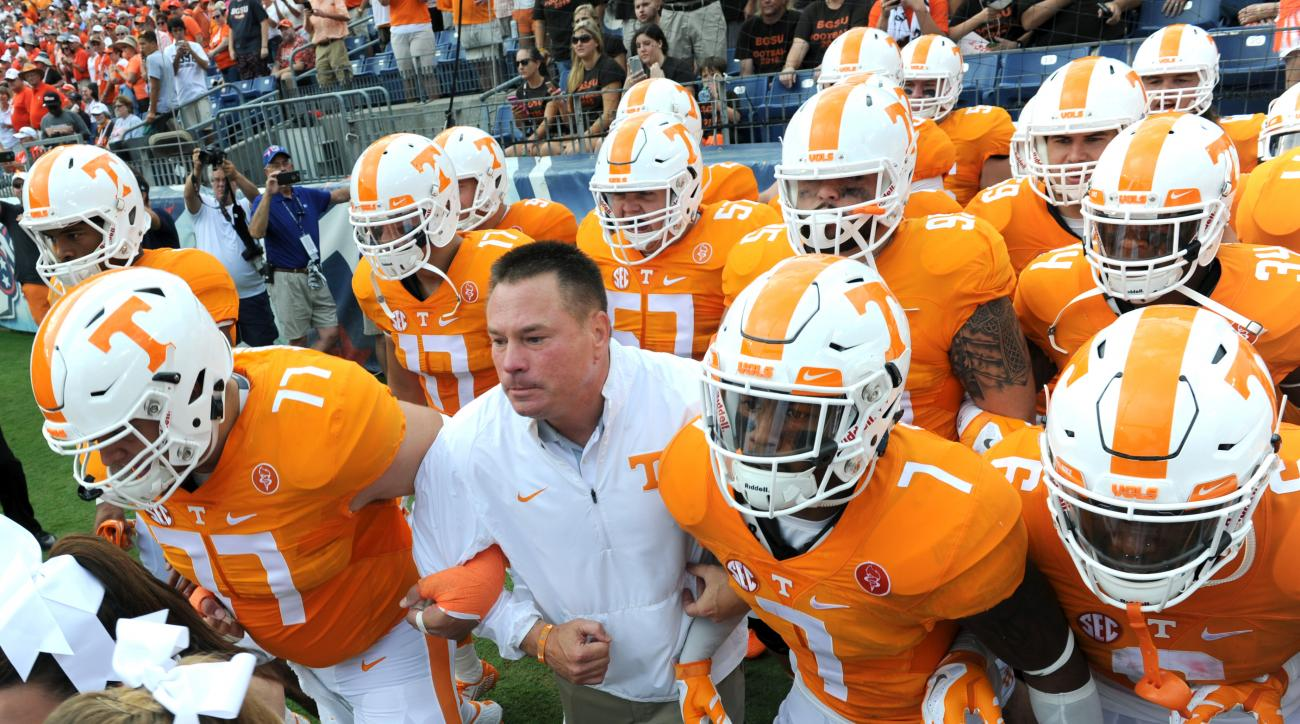 Tennessee head coach Butch Jones leads his team onto the field for the first half of an NCAA college football game against Bowling Green in Nashville, Tenn., Saturday, Sept. 5, 2015. (Michael Patrick/Knoxville News Sentinel via AP) MANDATORY CREDIT