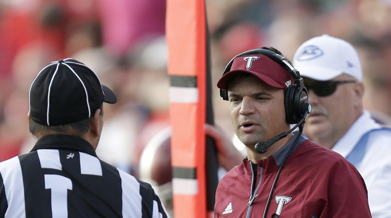 Troy coach Neal Brown speaks with an official during the first half of an NCAA college football game against North Carolina State in Raleigh, N.C., Saturday, Sept. 5, 2015. (AP Photo/Gerry Broome)