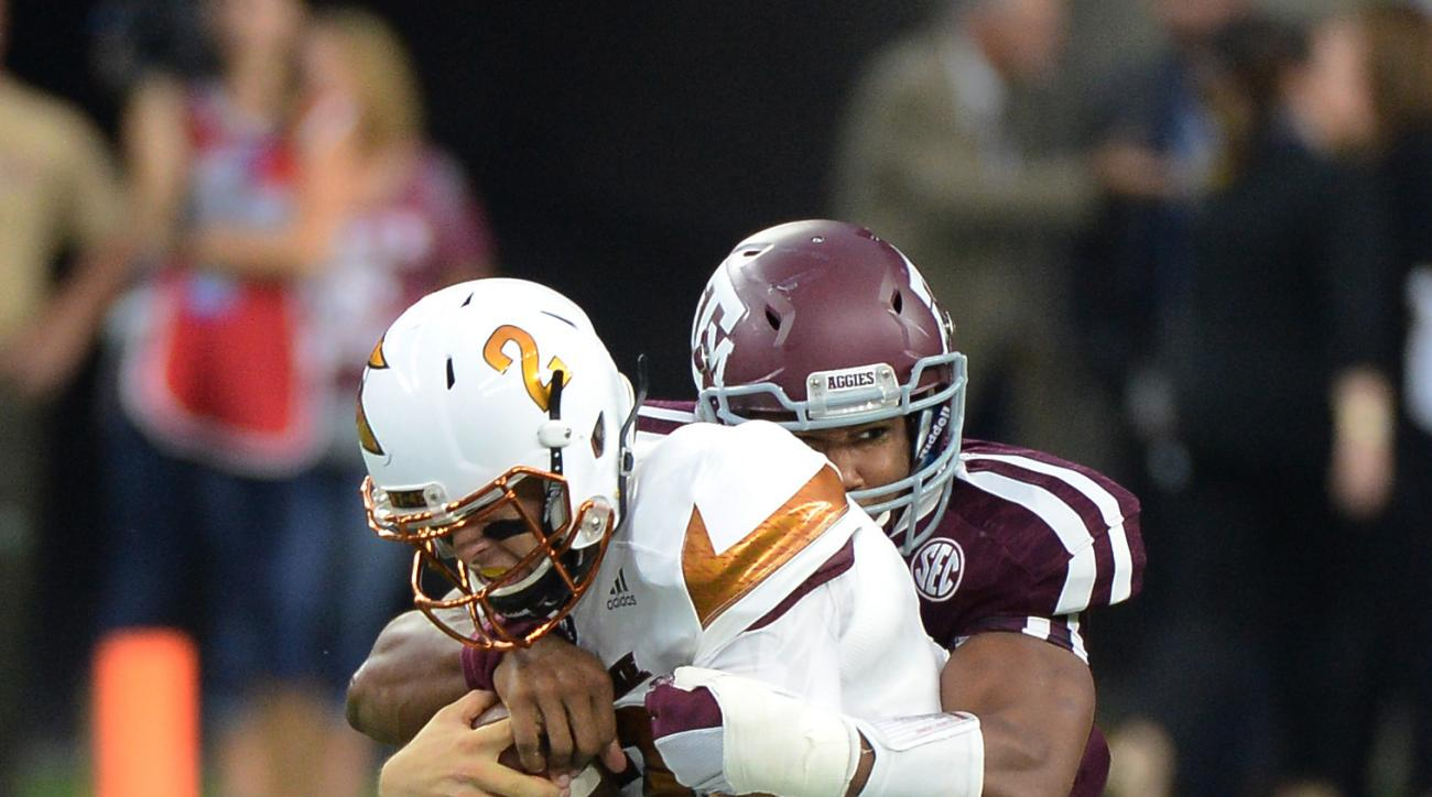 Arizona State quarterback Mike Bercovici (2) is wrapped up by Texas A&M defensive lineman Myles Garrett during the first half of an NCAA college football game Saturday, Sept. 5, 2015,  in Houston. (AP Photo/George Bridges)