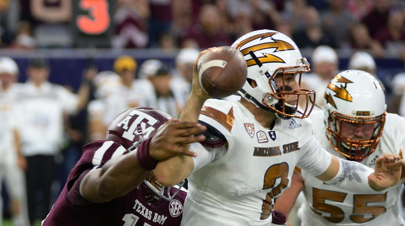 Arizona State quarterback Mike Bercovici (2) is pressured as he passes by Texas A&M defensive lineman Myles Garrett (15) during the first half of an NCAA football game on Saturday, Sept. 5, 2015, in Houston. (AP Photo/George Bridges)