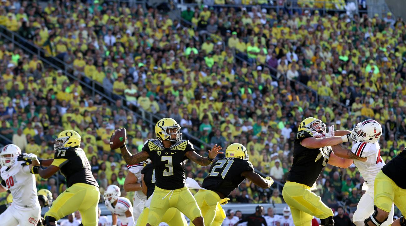 Oregon quarterback Vernon Adams Jr. (3) looks to throw during the second quarter of an NCAA college football game against Eastern Washington Saturday, Sept. 5, 2015, in Eugene, Ore. (AP Photo/Ryan Kang)