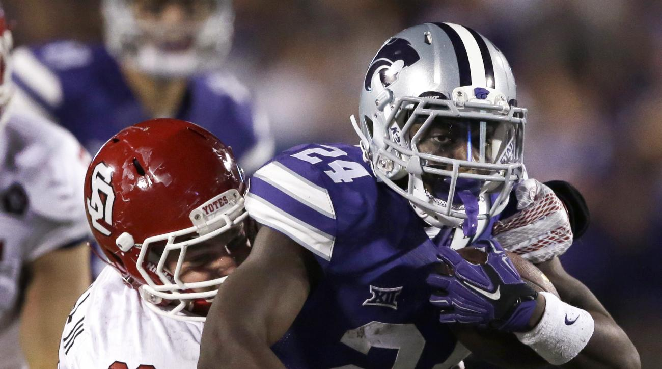 Kansas State running back Charles Jones (24) is tackled by South Dakota linebacker John Wessel (28) during the second half of an NCAA college football game in Manhattan, Kan., Saturday, Sept. 5, 2015. Kansas State won 34-0. (AP Photo/Orlin Wagner)