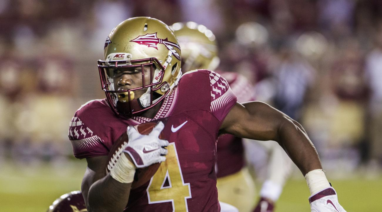 Florida State running back Dalvin Cook carries during the first half of an NCAA college football game against Texas State in Tallahassee, Fla., Saturday, Sept. 5, 2015. (AP Photo/Mark Wallheiser)