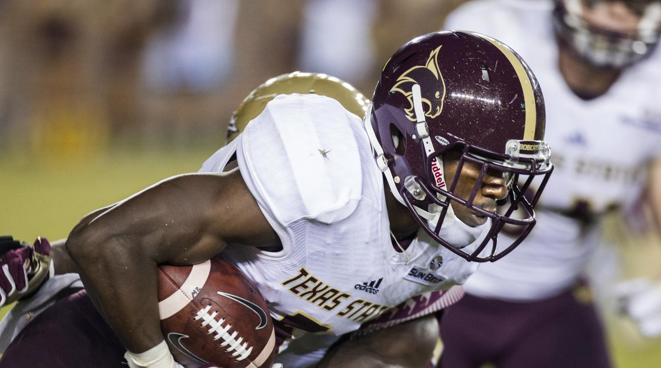 Texas State's Brandon Smith carries against Florida State during the first half of an NCAA college football game in Tallahassee, Fla., Saturday, Sept. 5, 2015. (AP Photo/Mark Wallheiser)