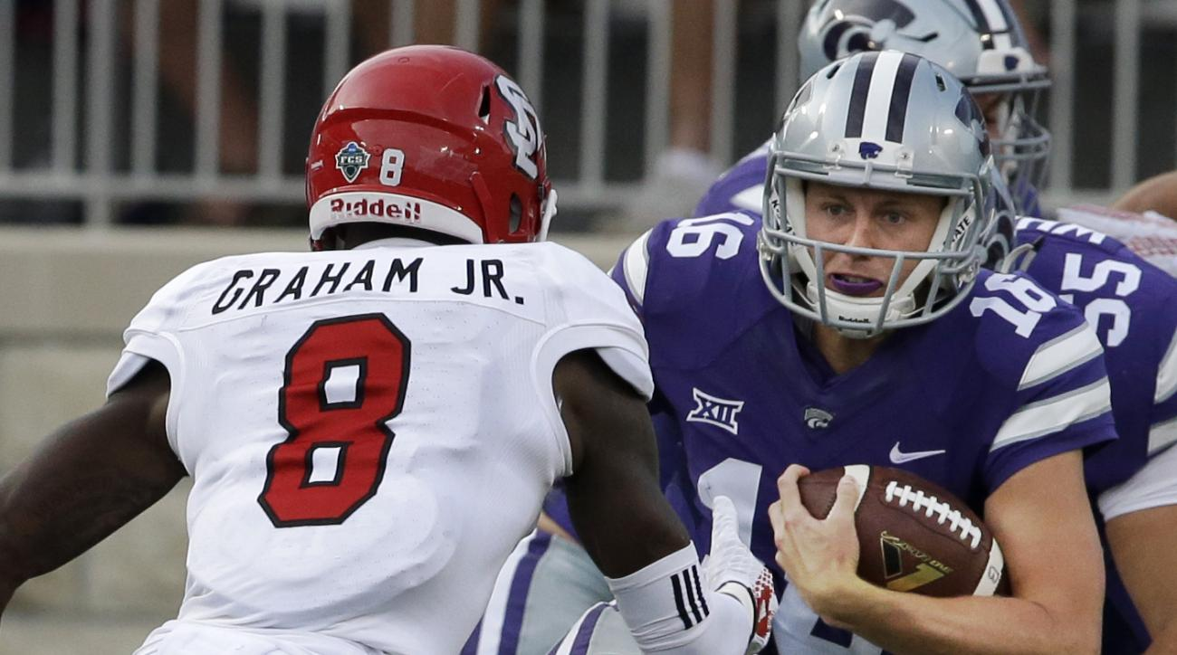 Kansas State quarterback Jesse Ertz (16) tries to avoid South Dakota defensive back Tyson Graham (8) during the first half of an NCAA college football game in Manhattan, Kan., Saturday, Sept. 5, 2015. Ertz was injured on the play and replaced by Joe Huben