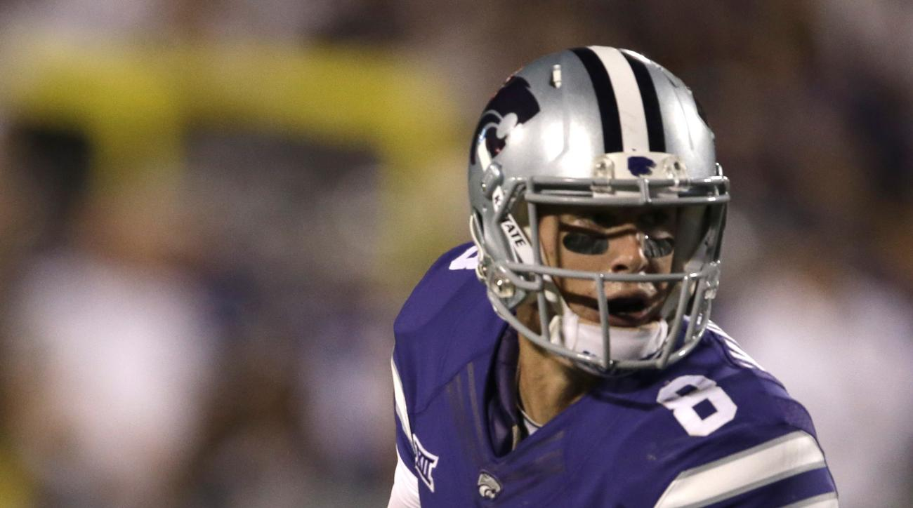 Kansas State quarterback Joe Hubener (8) looks for a receiver during the second half of an NCAA college football game against South Dakota in Manhattan, Kan., Saturday, Sept. 5, 2015. Kansas State won 34-0. (AP Photo/Orlin Wagner)