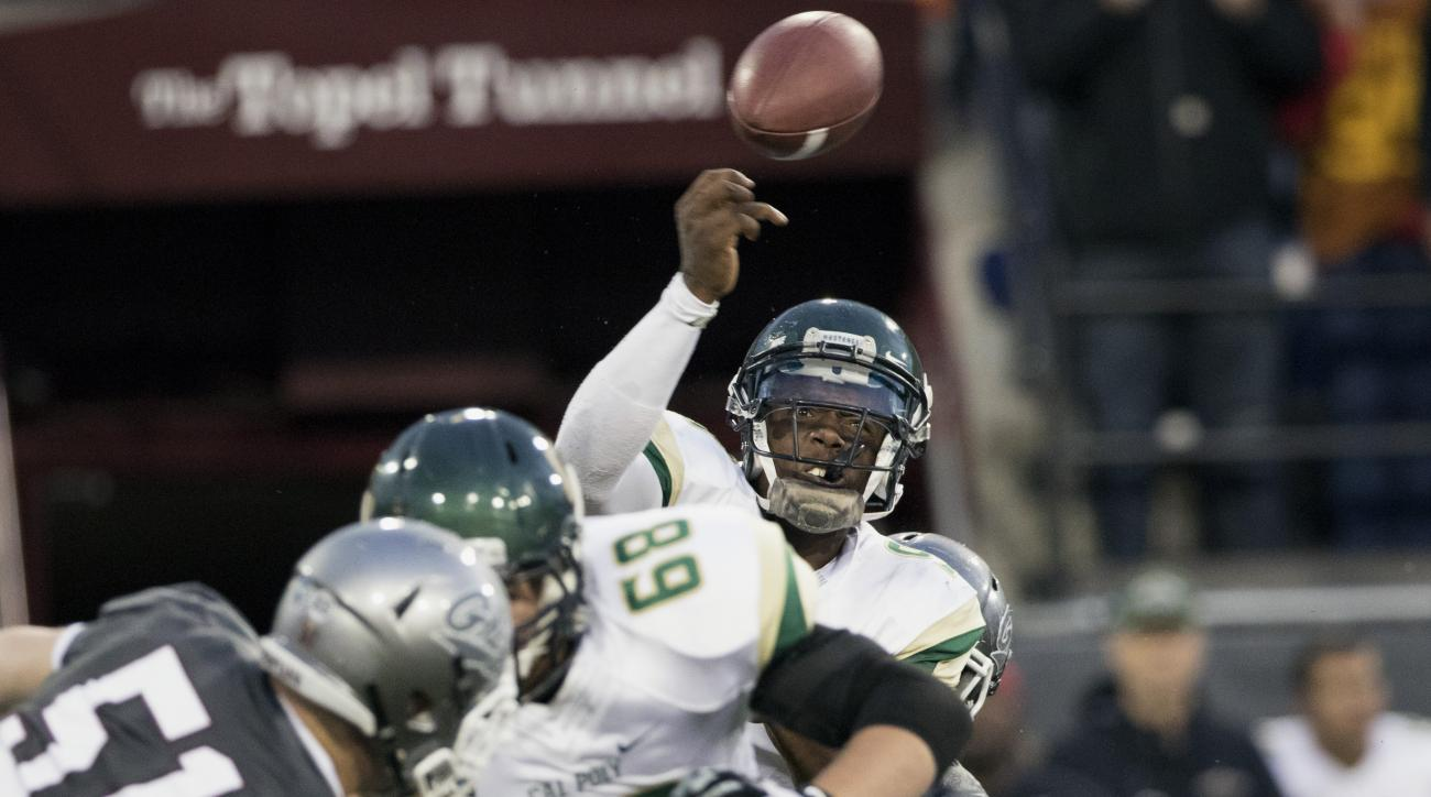 Cal Poly quarterback Chris Brown (9) drops a throw as he is hit by the Montana defense during the first half of an NCAA college football game Saturday, Sept. 5, 2015, in Missoula, Mont. (AP Photo/Patrick Record)