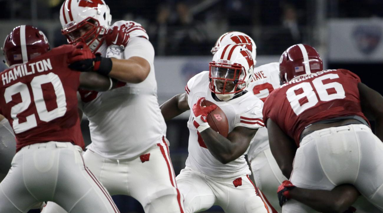 Wisconsin running back Corey Clement looks for room as teammate offensive lineman Walker Williams blocks Alabama linebacker Shaun Hamilton (20) during the first half of an NCAA college football game Saturday, Sept. 5, 2015, in Arlington, Texas. Alabama  w