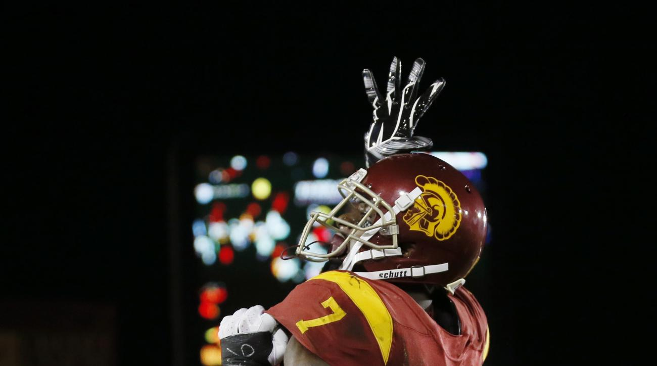 Southern California wide receiver Steven Mitchell, top, celebrates his touchdown against Arkansas State with guard Toa Lobendahn during the first half of an NCAA college football game, Saturday, Sept. 5, 2015, in Los Angeles. (AP Photo/Danny Moloshok)