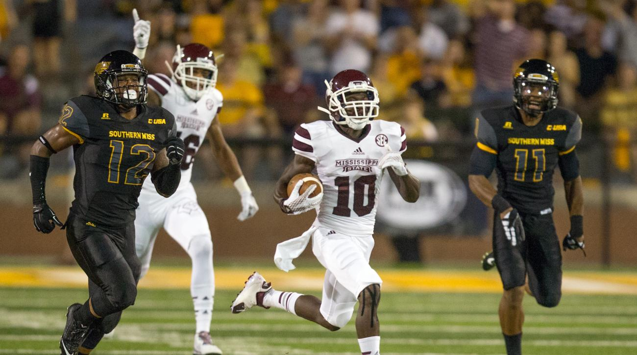 Mississippi State running back Brandon Holloway (10) breaks through a hole in the Southern Mississippi kick coverage to score a touchdown to give MSU a 7-3 lead in the first quarter of an NCAA college football game on Saturday, Sept. 5, 2015 in Hattiesbur