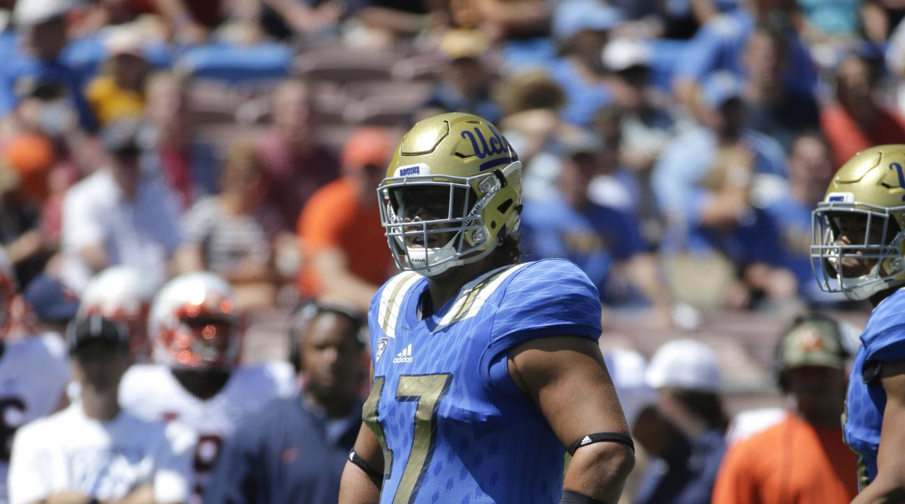 In this Saturday, Sept. 5, 2015 photo, UCLA defensive lineman Eddie Vanderdoes stands on the field during the first half of an NCAA college football game against Virginia at Rose Bowl in Pasadena, Calif. Vanderdoes tore a ligament in his knee during the U