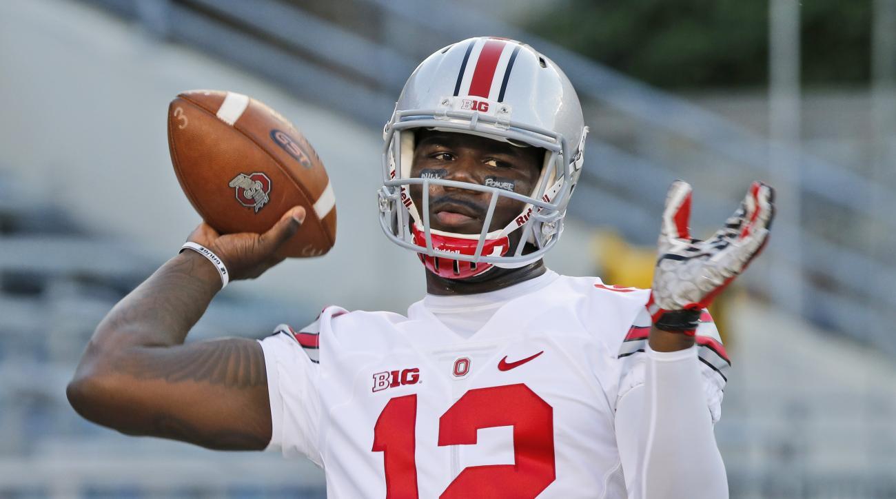 Ohio State quarterback Cardale Jones (12) warms up before an NCAA college football game against Virginia Tech in Blacksburg, Va., Monday, Sept. 7, 2015. (AP Photo/Steve Helber)