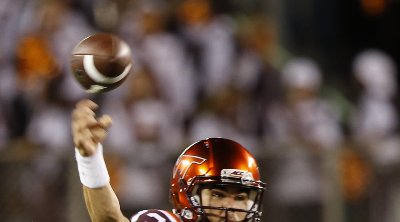 Virginia Tech quarterback Michael Brewer (12) throws the ball during the first half of an NCAA college football game against Ohio State in Blacksburg, Va., Monday, Sept. 7, 2015. (AP Photo/Steve Helber)