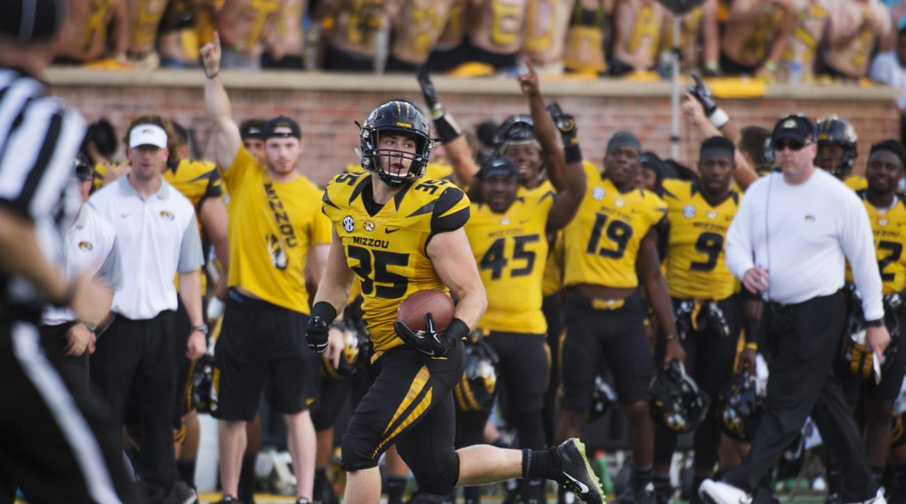 FILE - In this Sept. 5, 2015, file photo, Missouri's Tyler Hunt runs toward the end zone as he scores on a 78-yard reception during the fourth quarter of an NCAA college football game against Southeast Missouri State in Columbia, Mo. Missouri won the game