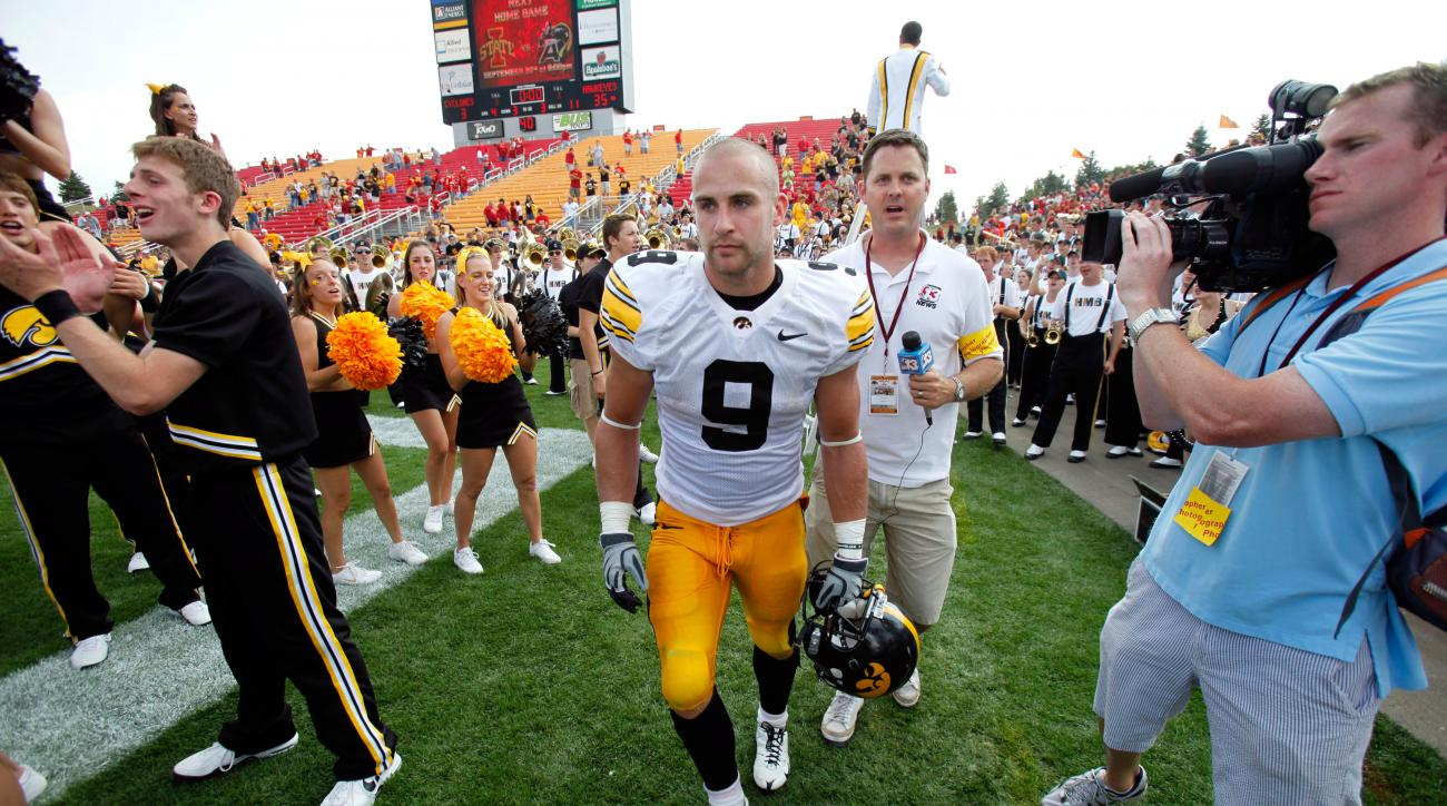 FILE - In this Sept. 12, 2009, file photo, Iowa's Tyler Sash runs off the field after his team's 35-3 win over Iowa State in an NCAA college football game in Ames, Iowa. Former Iowa football star Tyler Sash, who later player two seasons with the New York