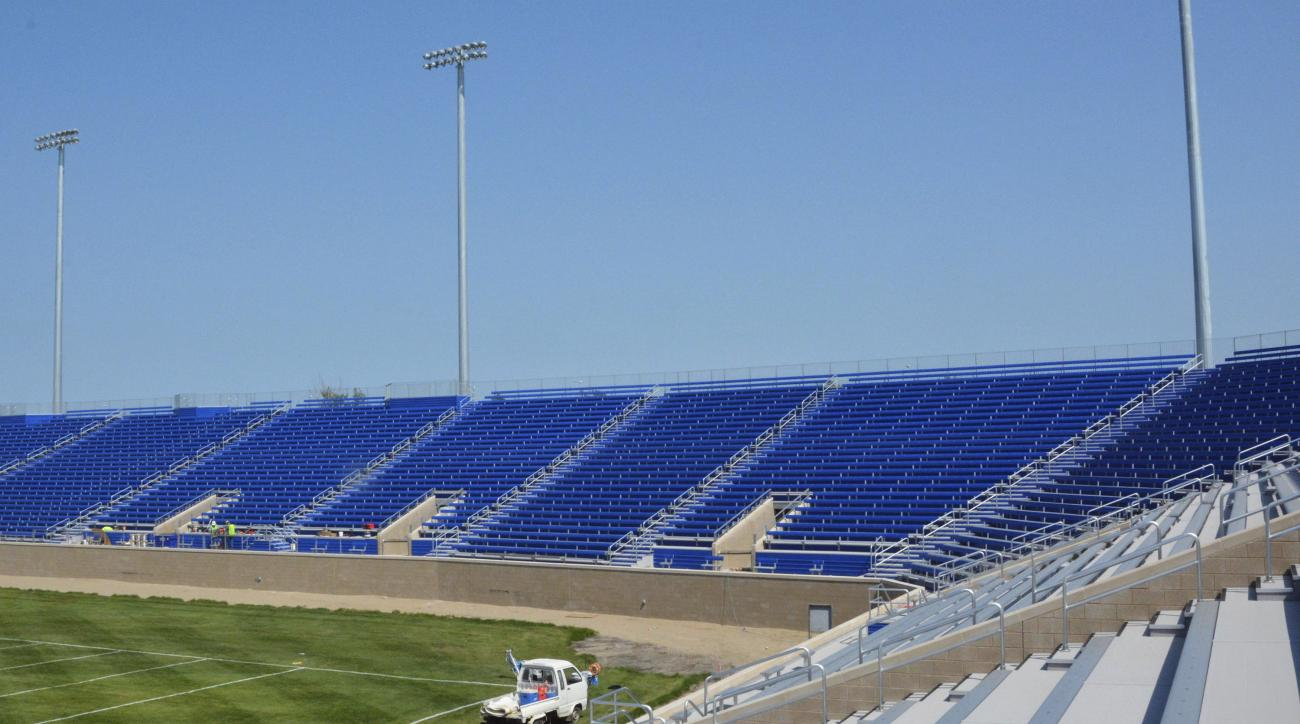 In this Aug. 26, 2015 photo, construction of new wraparound seating to replace the visitor-side bleachers and student section at Coughlin-Alumni Stadium stands nearly complete on the South Dakota State campus in Brookings S.D. The addition brings seating