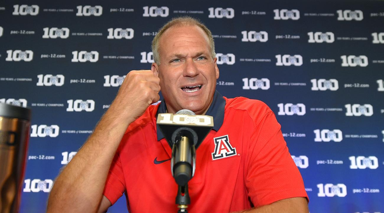 FILE - In this July 31, 2015, file photo, Arizona head coach Rich Rodriguez speaks to reporters during NCAA college Pac-12 Football Media Days in Burbank, Calif. Amid the video game-like passing numbers seen across college football in recent years, rushin