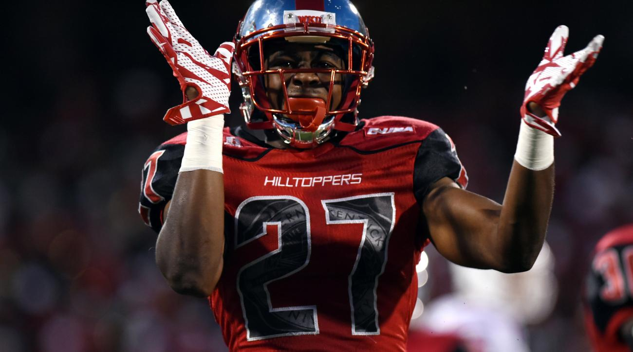 Western Kentucky defensive back Martavius Mims (27) celebrates a play in the first half of an NCAA college football game against Louisiana Tech, Thursday, Sept. 10, 2015, in Bowling Green, Ky. (AP Photo/Michael Noble Jr.)
