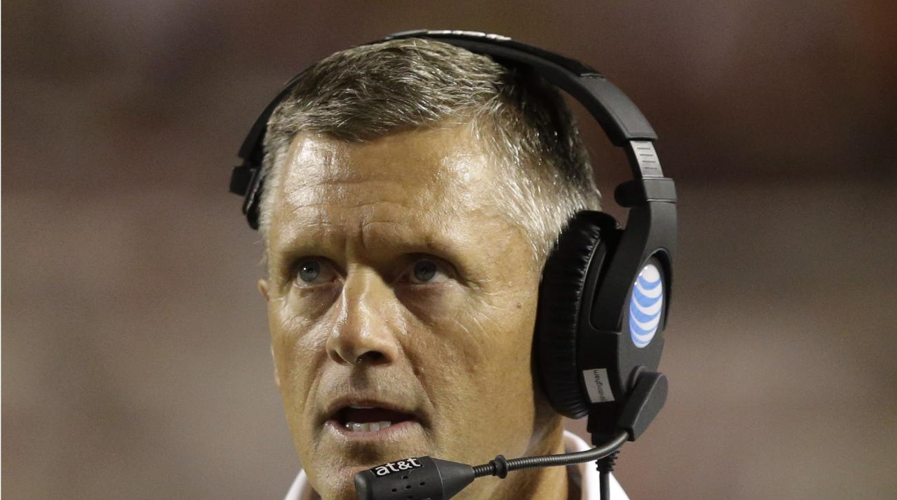 Utah head coach Kyle Whittingham looks at the scoreboard in the second half during an NCAA college football game against Utah State Friday, Sept. 11, 2015, in Salt Lake City.  Utah won 24-14. (AP Photo/Rick Bowmer)