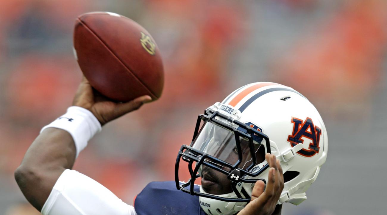Auburn quarterback Jeremy Johnson (6) warms up before the first half of an NCAA college football game against Jacksonville State, Saturday, Sept. 12, 2015, in Auburn, Ala. (AP Photo/Butch Dill)