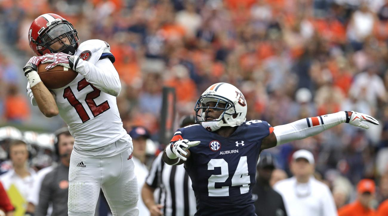 Jacksonville State wide receiver Josh Barge (12) catches a pass over Auburn defensive back Blake Countess (24) during the first half of an NCAA college football game, Saturday, Sept. 12, 2015, in Auburn, Ala. (AP Photo/Butch Dill)