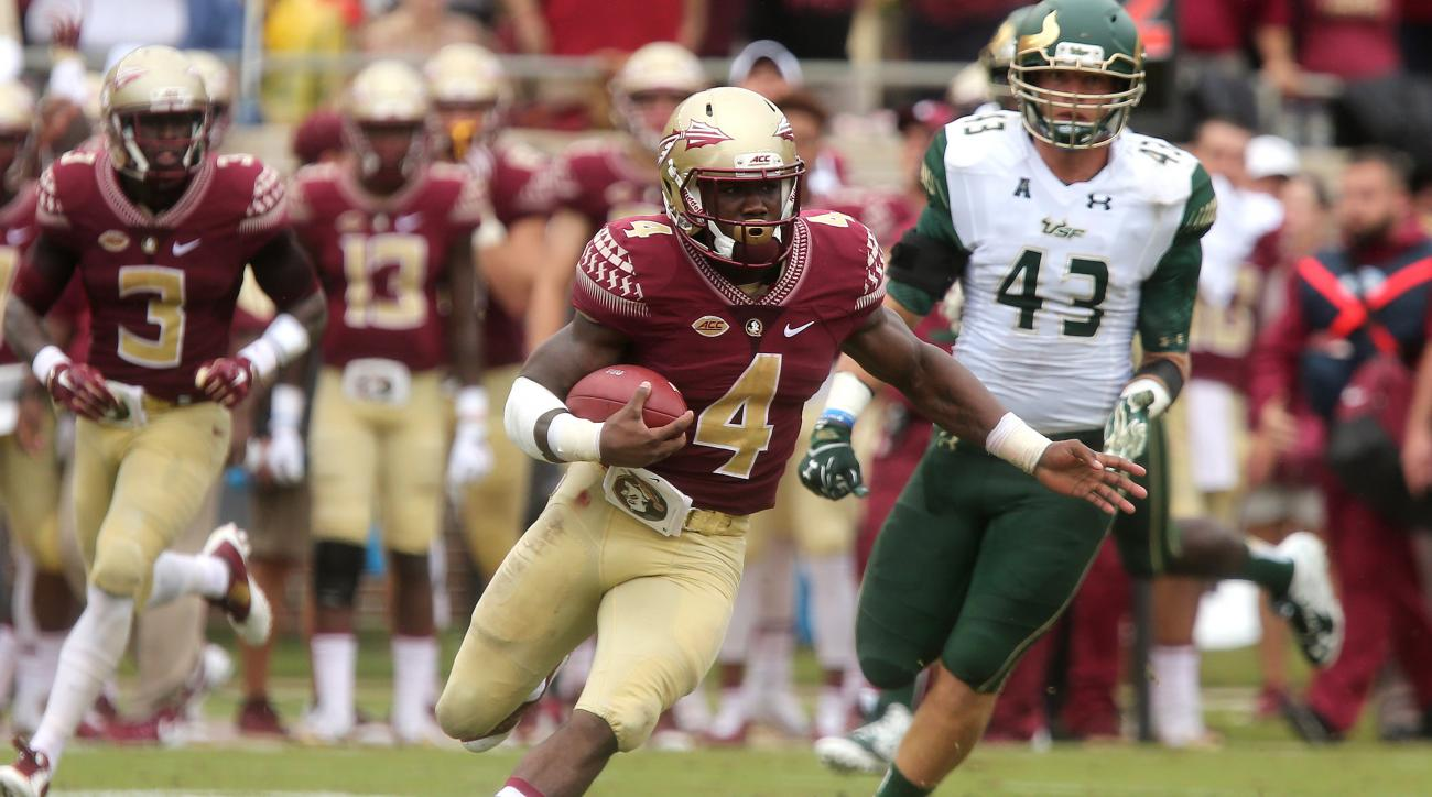 Florida State's Dalvin Cook, center, scampers 74 yards for a touchdown against South Florida during the first quarter of an NCAA college football game, Saturday, Sept. 12, 2015, in Tallahassee, Fla. (AP Photo/Steve Cannon)