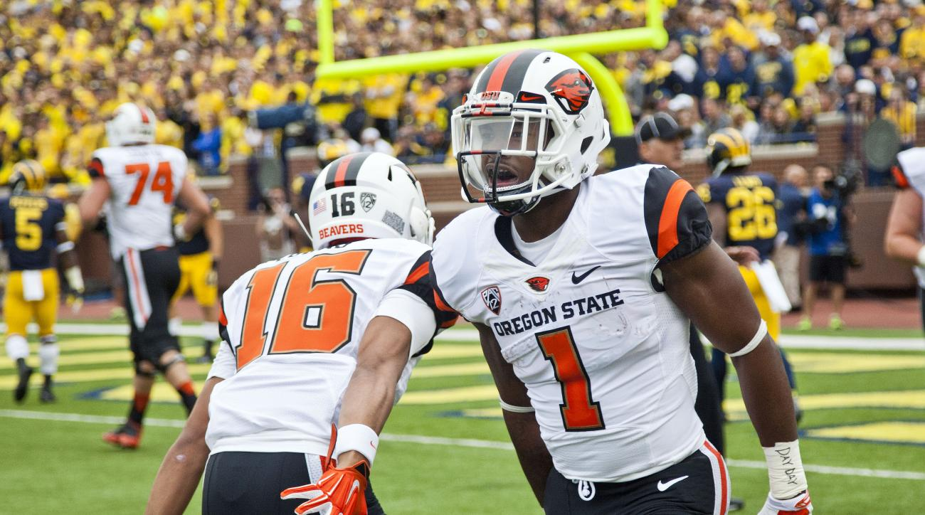 Oregon State running back Chris Brown (1) celebrates his touchdown in the first quarter of an NCAA college football game against Michigan in Ann Arbor, Mich., Saturday, Sept. 12, 2015. (AP Photo/Tony Ding)