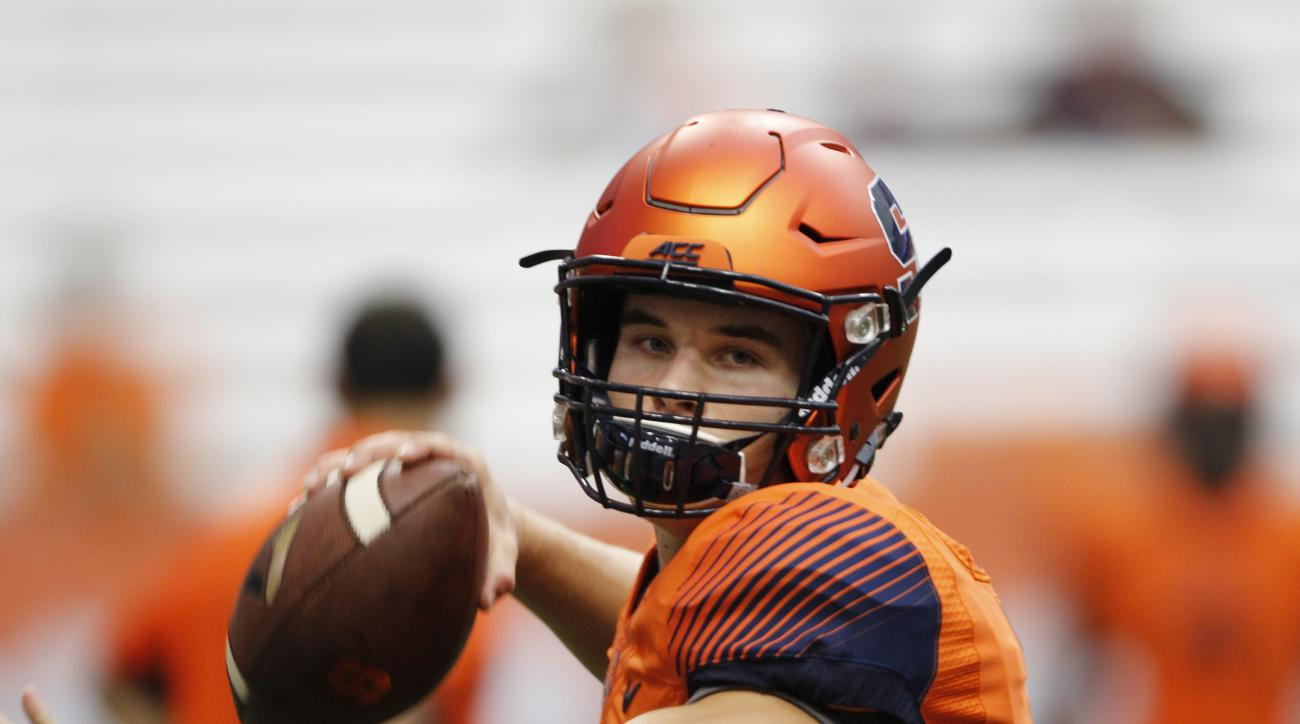 Syracuse's Eric Dungey warms up before the start of an NCAA college football game against Wake Forest in Syracuse, N.Y., Saturday, Sept. 12, 2015 (AP Photo/Nick Lisi)