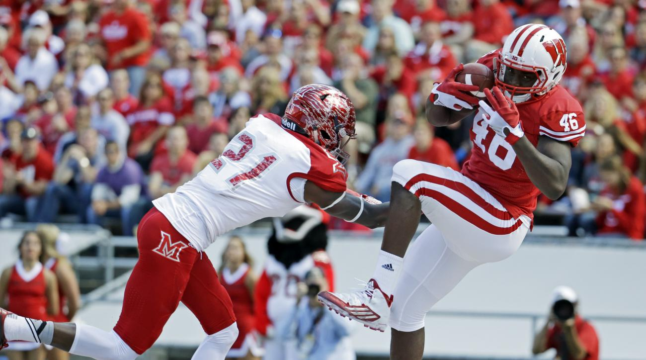 Wisconsin's Austin Traylor catches a touchdown pass in front of Miami of Ohio's Marshall Taylor (21) during the first half of an NCAA college football game, Saturday, Sept. 12, 2015, in Madison, Wis. (AP Photo/Morry Gash)