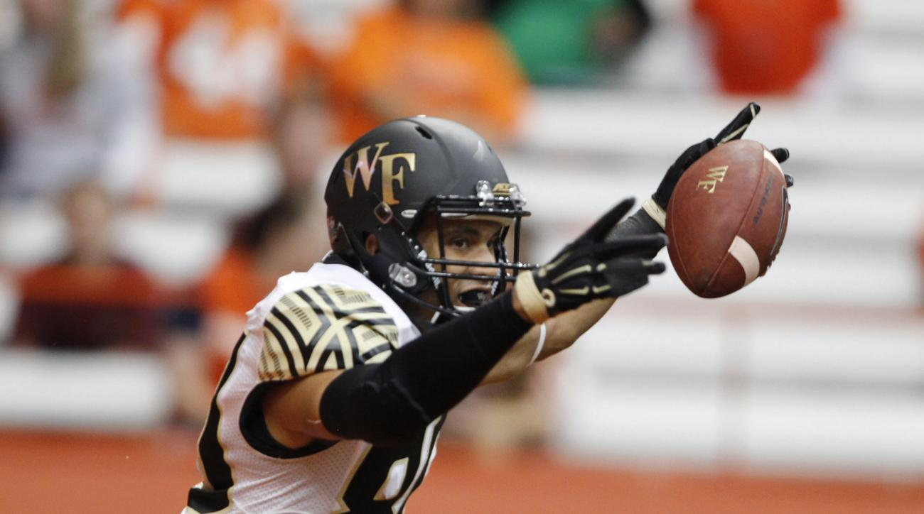 Wake Forest's KJ Brent celebrates after catching a touchdown pass in the first half of an NCAA college football game against Syracuse in Syracuse, N.Y., Saturday, Sept. 12, 2015. (AP Photo/Nick Lisi)