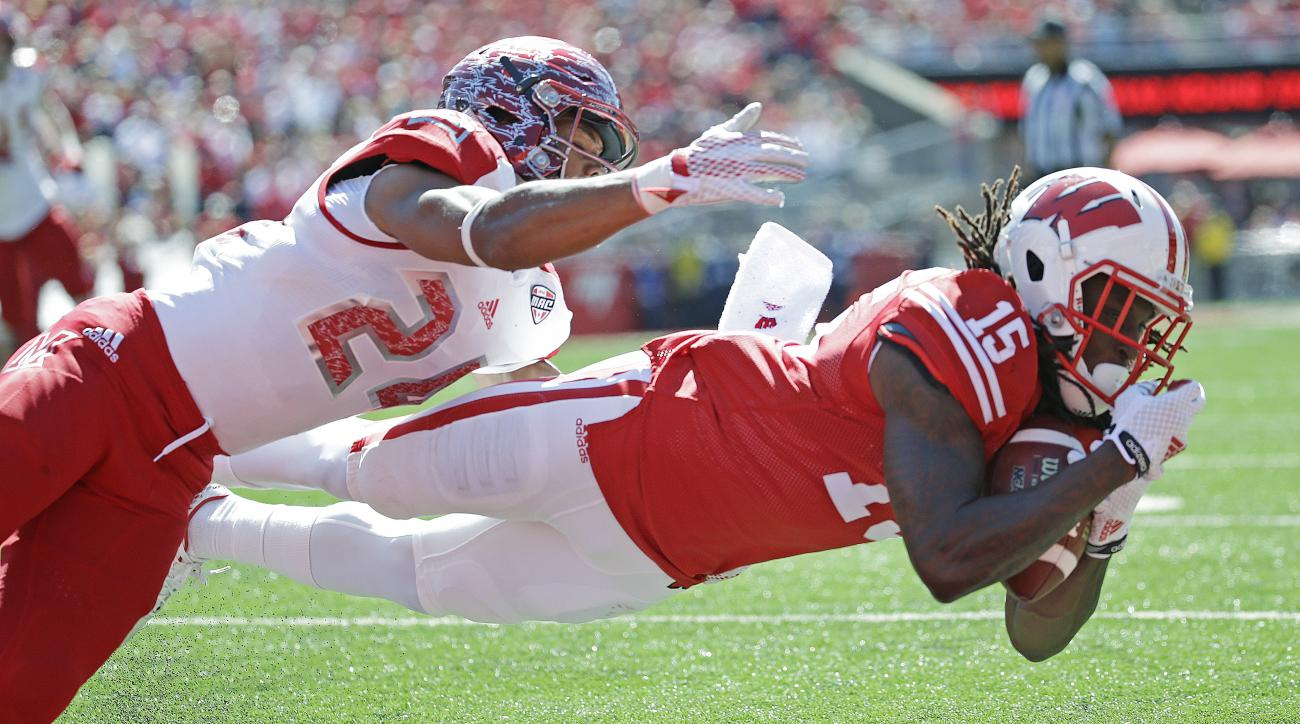 Wisconsin's Robert Wheelwright, right, catches a touchdown pass in front of Miami of Ohio's Heath Harding during the first half of an NCAA college football game, Saturday, Sept. 12, 2015, in Madison, Wis. (AP Photo/Morry Gash)