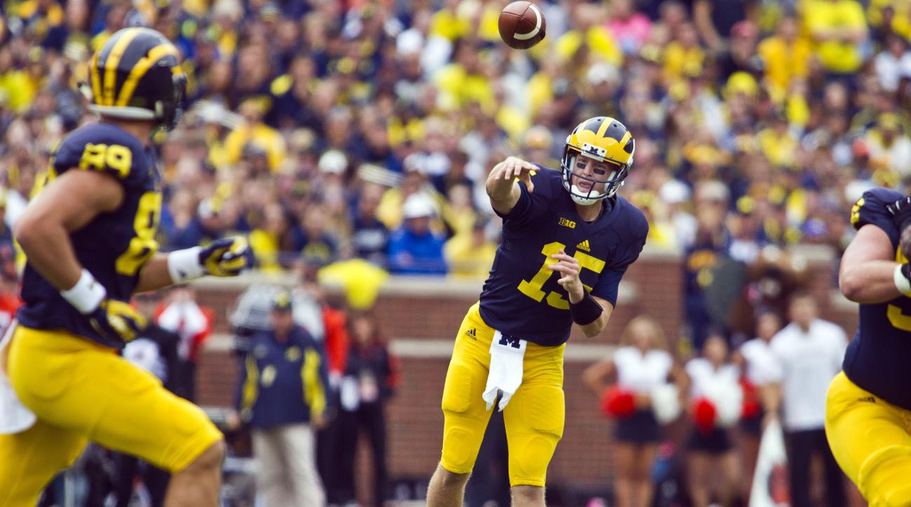 Michigan quarterback Jake Rudock (15) throws a pass towards tight end Jake Butt (88) in the second quarter of an NCAA college football game against Oregon State in Ann Arbor, Mich., Saturday, Sept. 12, 2015. (AP Photo/Tony Ding)