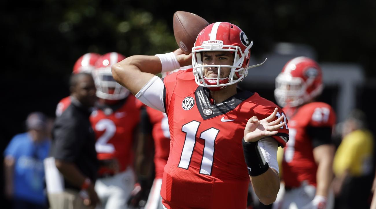 Georgia quarterback Greyson Lambert warms up before the start of an NCAA college football game against Vanderbilt Saturday, Sept. 12, 2015, in Nashville, Tenn. (AP Photo/Mark Humphrey)