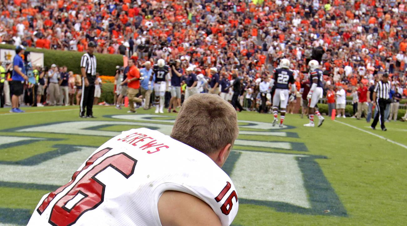 Jacksonville State wide receiver Dalton Screws (16) sits dejected in the end zone after Auburn clinches the win in overtime of an NCAA college football game, Saturday, Sept. 12, 2015, in Auburn, Ala.  Auburn won 27-20. (AP Photo/Butch Dill)
