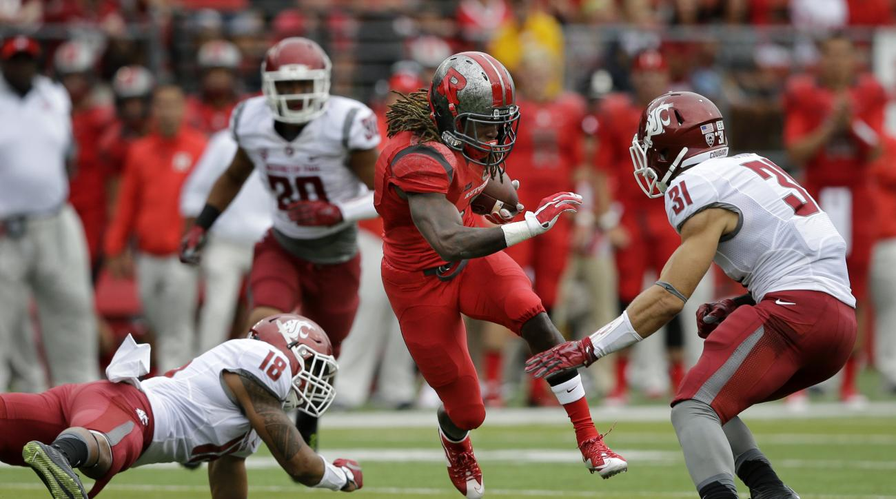 Rutgers wide receiver Janarion Grant (1) runs with the ball as runs with the ball as Washington State defenders Isaac Dotson (31) and Shalom Luani (18) try to make a tackle  during the first half of an NCAA college football game, Saturday, Sept. 12, 2015,