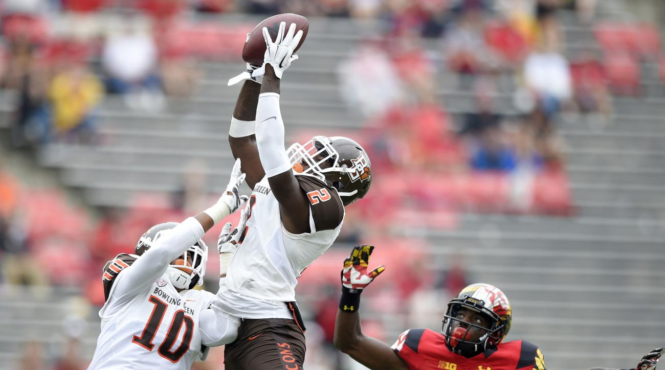 Bowling Green defensive back Clint Stephens (2) intercepts a pass intended for Maryland wide receiver Malcolm Culmer (83) during the second half of an NCAA college football game, Saturday, Sept. 12, 2015, in College Park, Md. Also seen is Bowling Green li