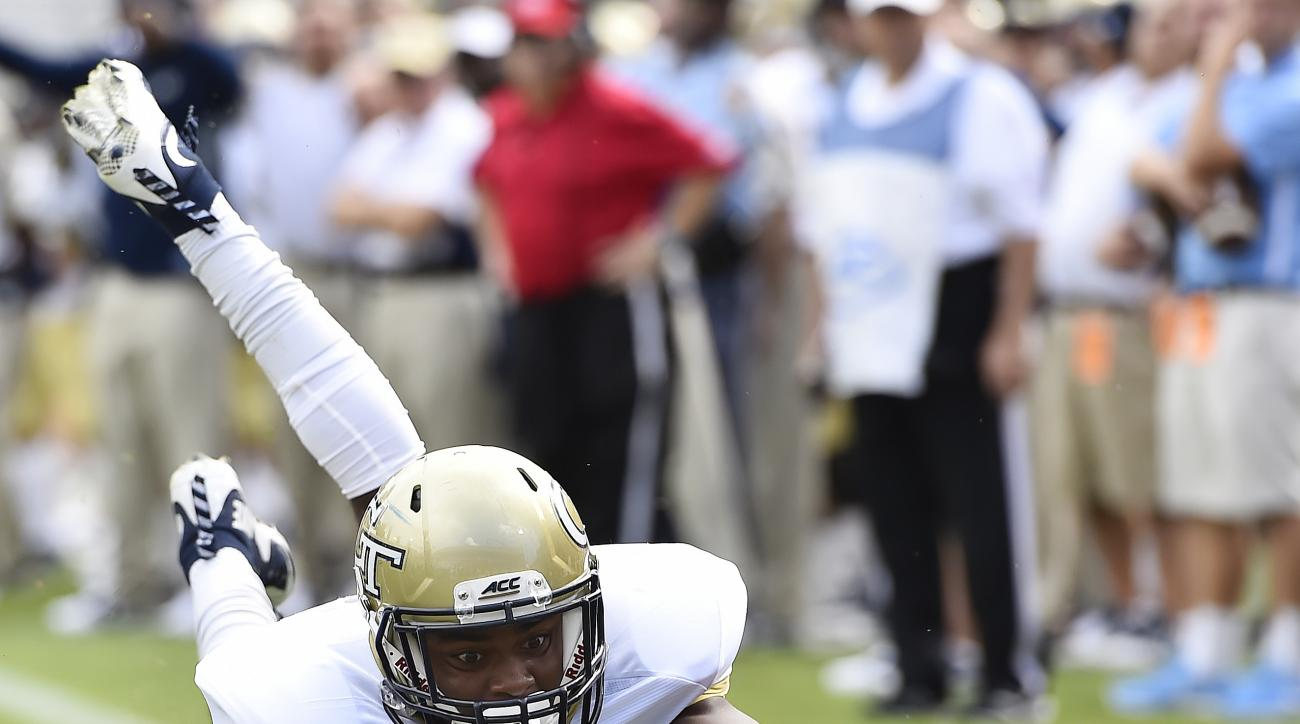 Georgia Tech running back Qua Searcy (1) leaps into the end zone for a touchdown against Tulane during the first half of an NCAA college football game, Saturday, Sept. 12, 2015, in Atlanta. (AP Photo/Mike Stewart)