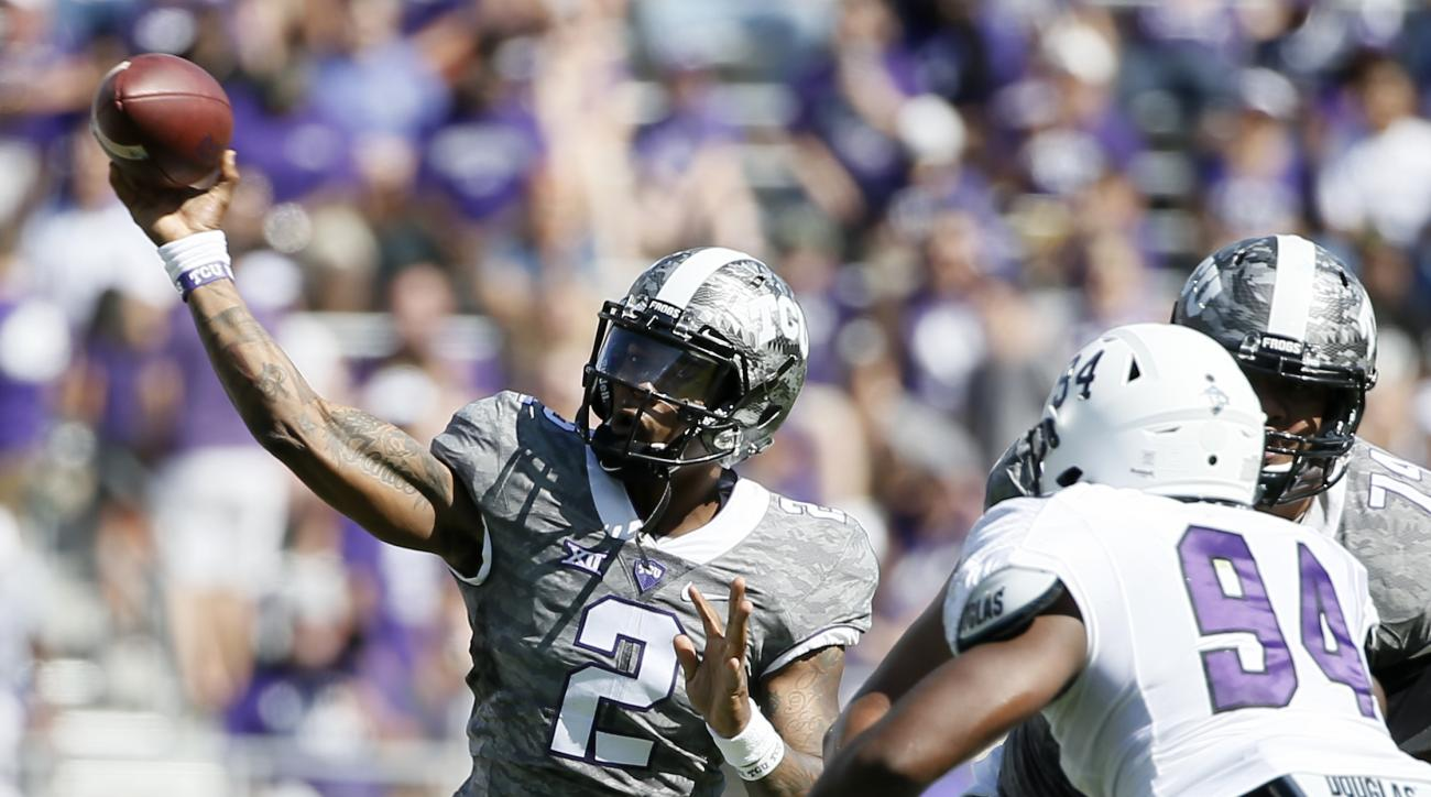TCU Horned Frogs quarterback Trevone Boykin (2) passes under pressure from Stephen F. Austin defensive tackle Demetrion Amie (94) in the first half of an NCAA college football game Saturday, Sept. 12, 2015, in Fort Worth, Texas. (AP Photo/Tony Gutierrez)