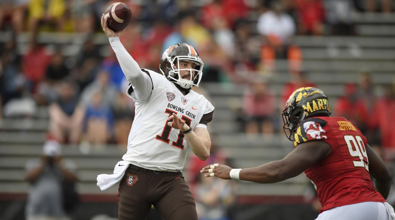 Bowling Green quarterback Matt Johnson (11) passes against Maryland defensive lineman Quinton Jefferson (99) during the second half of an NCAA college football game, Saturday, Sept. 12, 2015, in College Park, Md. Bowling Green won 48-27. (AP Photo/Nick Wa