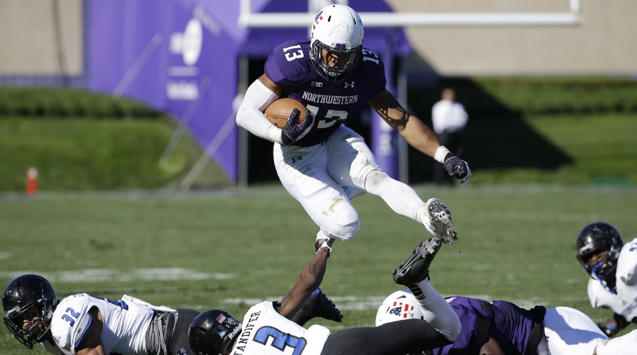 Northwestern running back Warren Long jumps as he runs with the ball during the first half of an NCAA college football game against Eastern Illinois, Saturday, Sept. 12, 2015, in Evanston, Ill. (AP Photo/Nam Y. Huh)