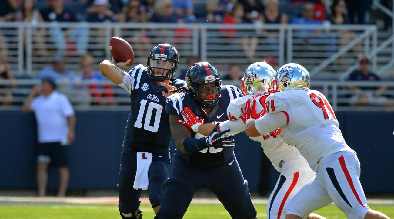 Mississippi quarterback Chad Kelly (10) releases a pass during the first half of an NCAA college football game against Fresno State in Oxford, Miss., Saturday, Sept. 12, 2015. (AP Photo/Thomas Graning)