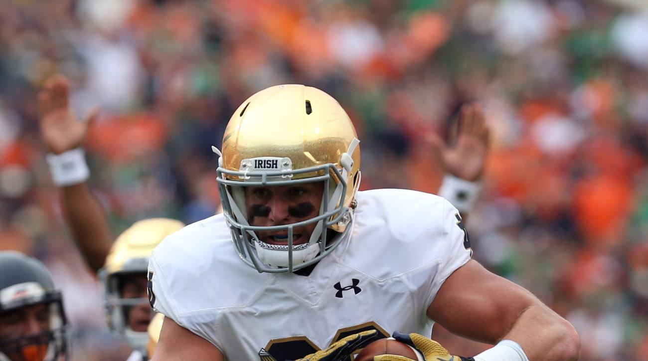 Notre Dame tight end Durham Smythe (80) runs the ball in for a touchdown during an NCAA college football game against Virginia, Saturday, Sept. 12, 2015, in Charlottesville, Va. (AP Photo/Andrew Shurtleff)