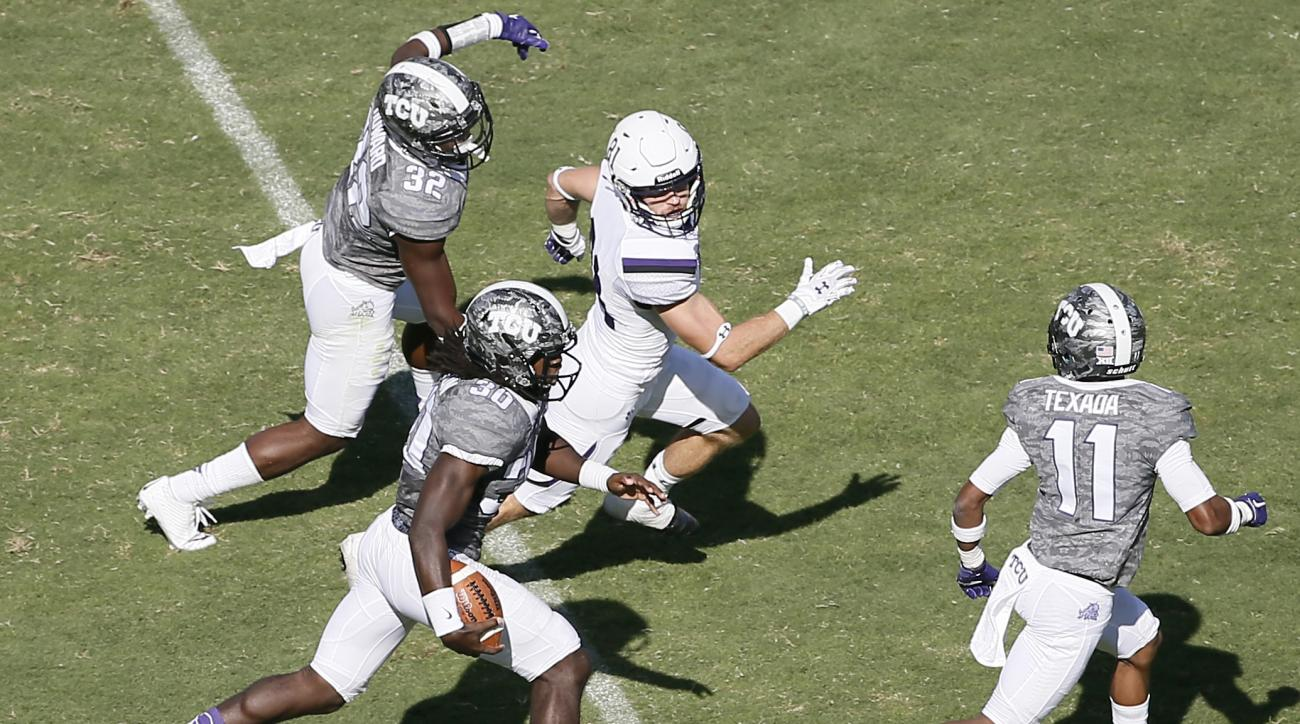TCU safety Denzel Johnson (30) runs an interception back for a touchdown as Stephen F. Austin wide receiver Aaron Thomas (81) gives chase in the second half of an NCAA college football game Saturday, Sept. 12, 2015, in Fort Worth, Texas. TCU's Ranthony Te