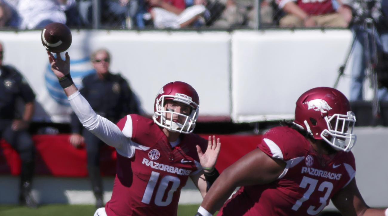 Arkansas quarterback Brandon Allen (10) passes over offensive lineman Sebastian Tretola (73) during the first quarter of an NCAA college football game against Toledo in Little Rock, Ark., Saturday, Sept. 12, 2015. (AP Photo/Danny Johnston)