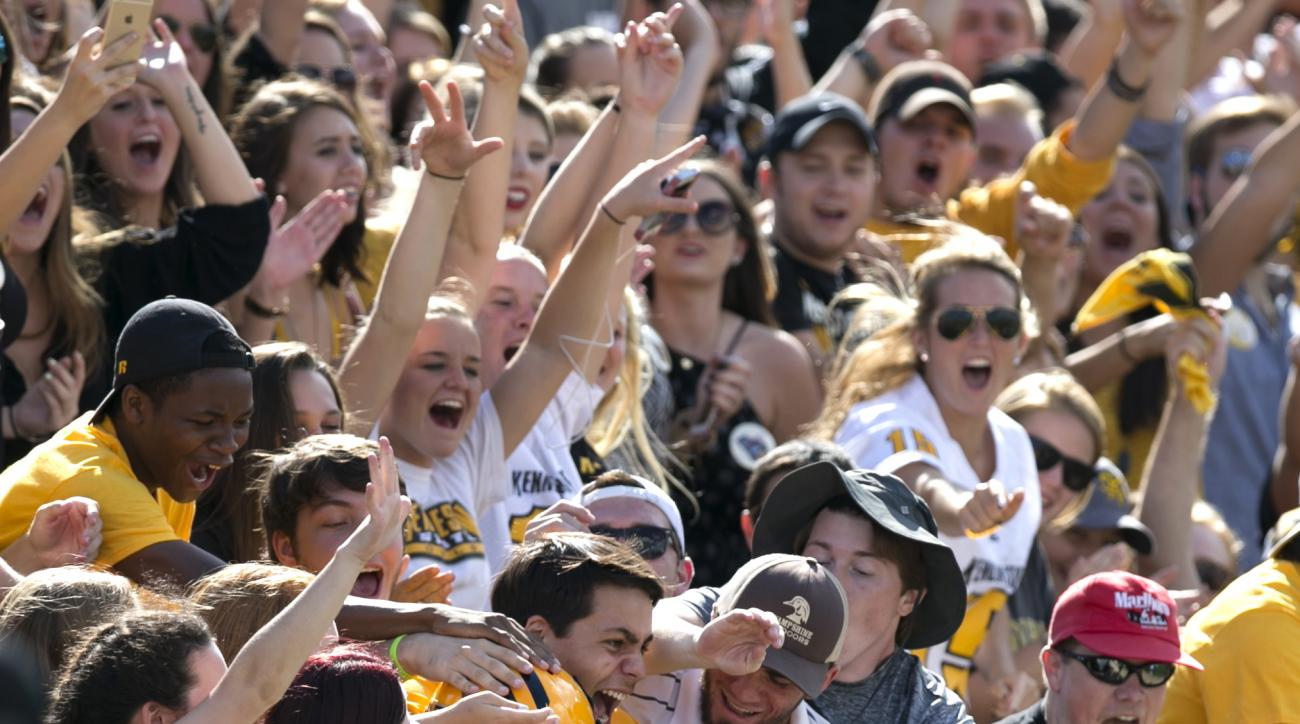 Kennesaw State quarterback Trey White (10) celebrates his rushing touchdown in the student section during the first quarter against Edward Waters in an NCAA college football game Saturday, Sept. 12, 2015, in Kennesaw, Ga. (Jason Getz/Atlanta Journal-Const