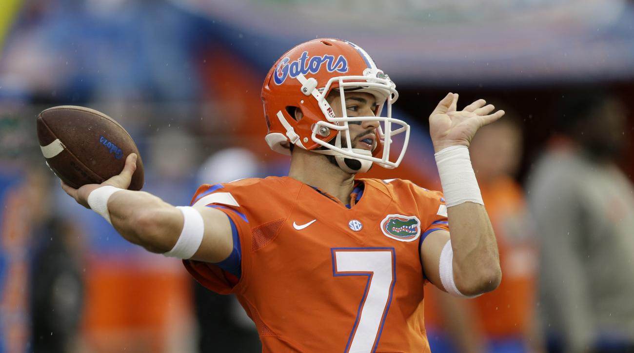 Florida quarterback Will Grier warms up before an NCAA college football game against East Carolina, Saturday, Sept. 12, 2015, in Gainesville, Fla. (AP Photo/John Raoux)