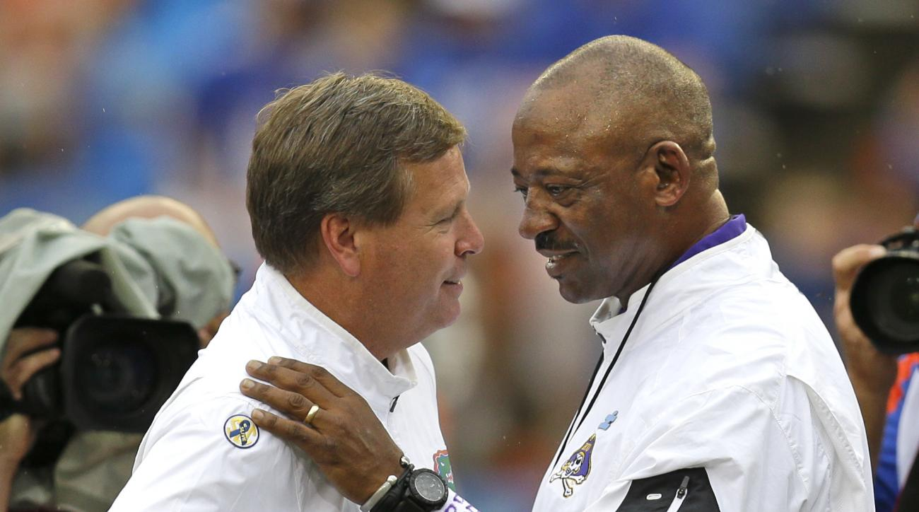 Florida head coach Jim McElwain, left, and East Carolina head coach Ruffin McNeill greet each other on the field before an NCAA college football game, Saturday, Sept. 12, 2015, in Gainesville, Fla. (AP Photo/John Raoux)