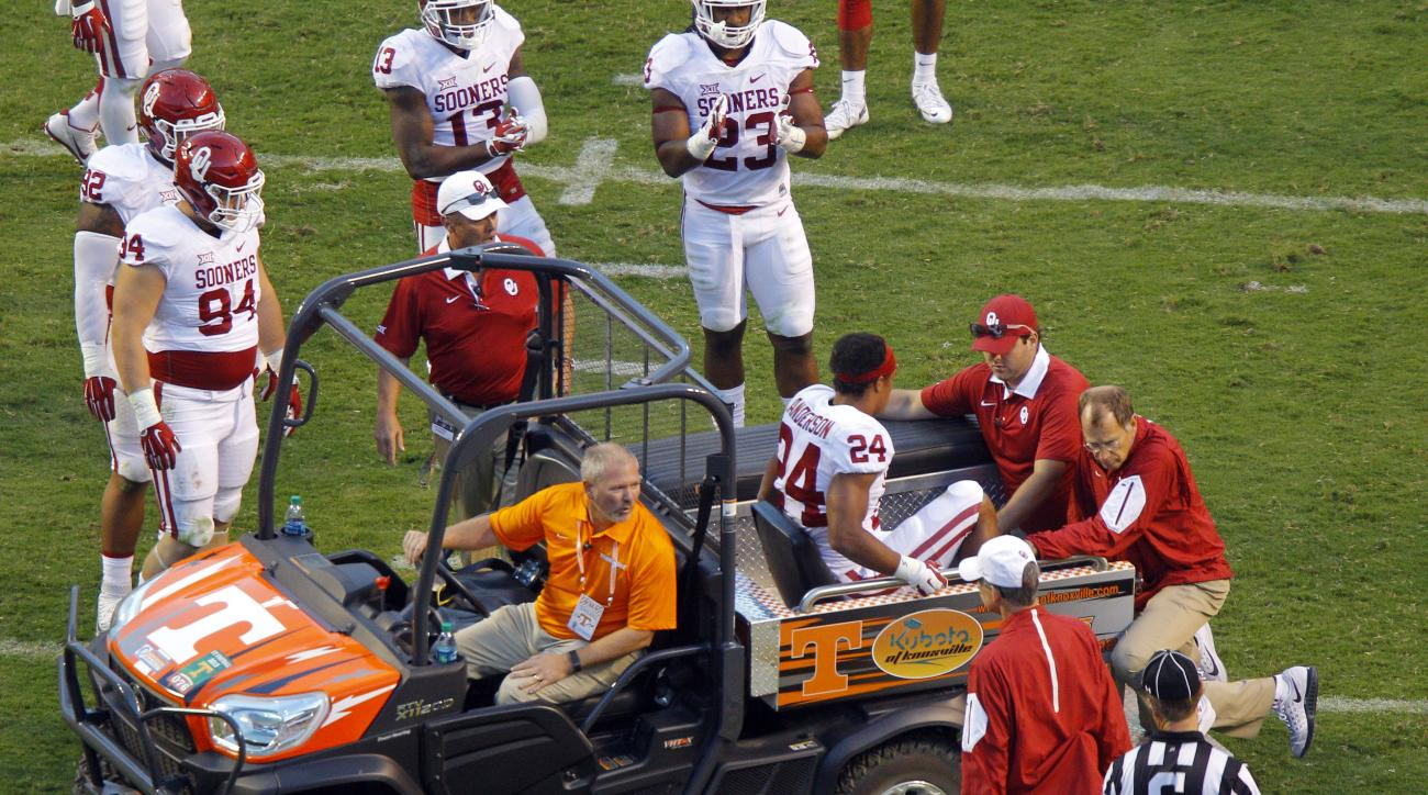 Oklahoma running back Rodney Anderson (24) is taken from the field after being injured during the first half of an NCAA college football game against Tennessee, Saturday, Sept. 12, 2015 in Knoxville, Tenn. (AP Photo/Wade Payne)