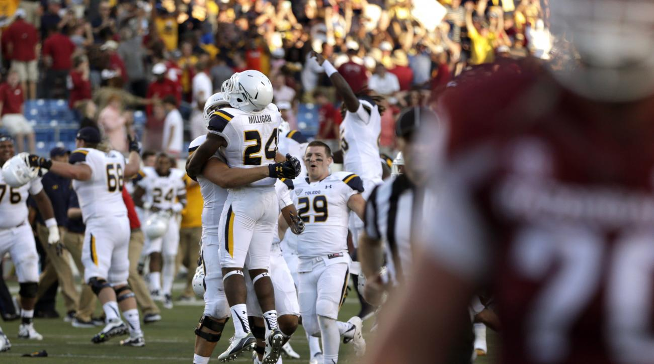 Toledo running back Damion Jones-Moore (24) celebrates after an NCAA college football game  against Arkansas in Little Rock, Ark., Saturday, Sept. 12, 2015. Toledo won 16-12. (AP Photo/Danny Johnston)