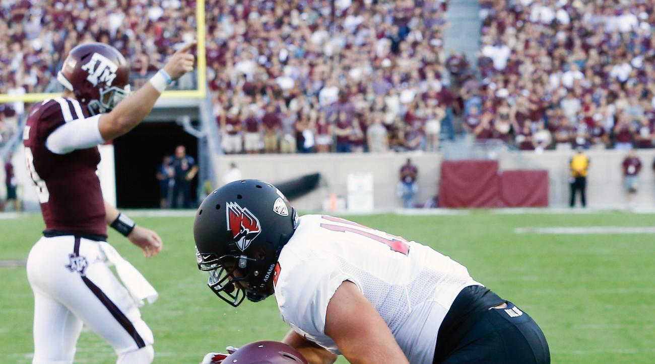 Texas A&M running back Tra Carson, front left, scores in the first quarter as Ball State linebacker Ben Ingle (19) is unable to make the tackle of an NCAA college football game Saturday, Sept. 12, 2015, in College Station, Texas. (AP Photo/Bob Levey)